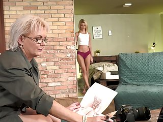 Sexy GILF photographer having sex with a pretty young woman