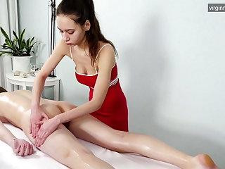 Busty brunette Russian babe Nevet Nikolet gets massaged