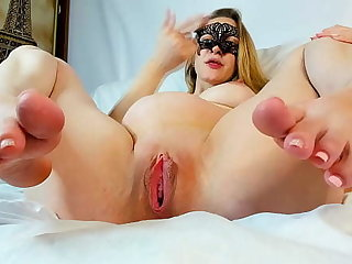 A pregnant woman fucks her wet pussy with a dildo
