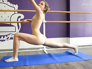 Zealous flexible hottie Julia Fiatal flashes bosom and nice bum as she does stretching